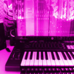 Magenta colored keyboards and speakers